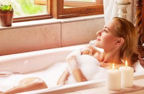 Lady relaxing in bath tub